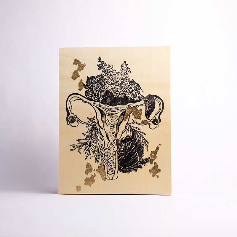 Maria Mulder's Floral Uterus linocut on wood panel with gold leaf