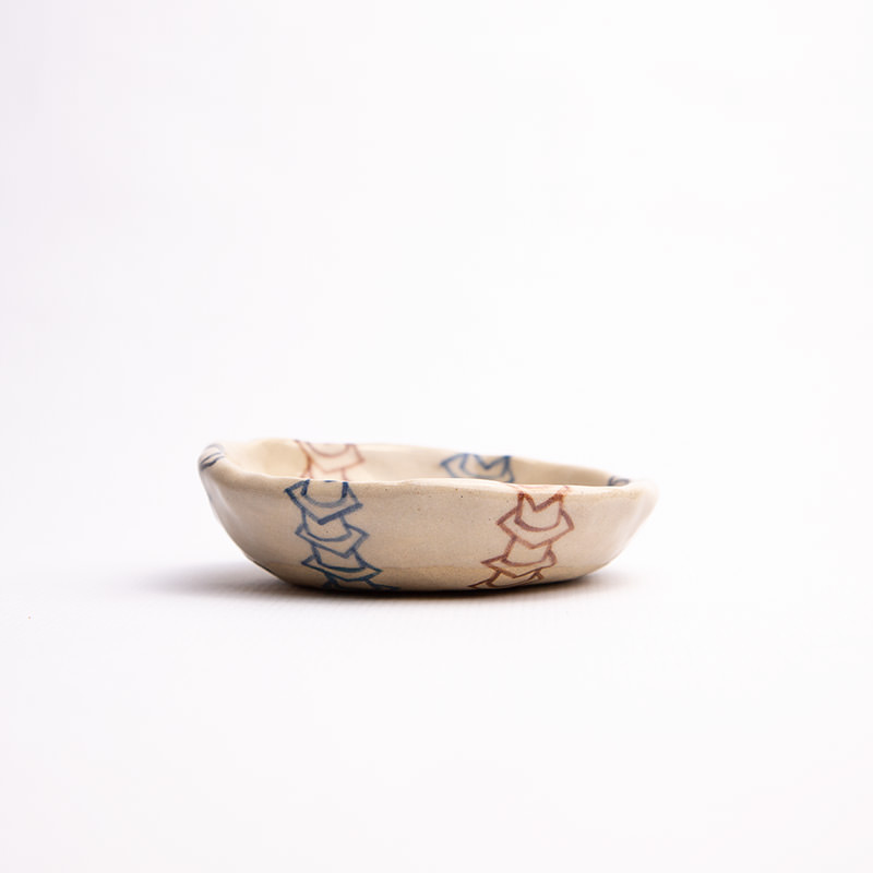 Sunny Nestler's Triple Worm Bowl, a ceramics piece pictured against a white backdrop (side view)